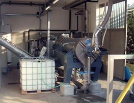 Decanter centrifuge system with discharge bin